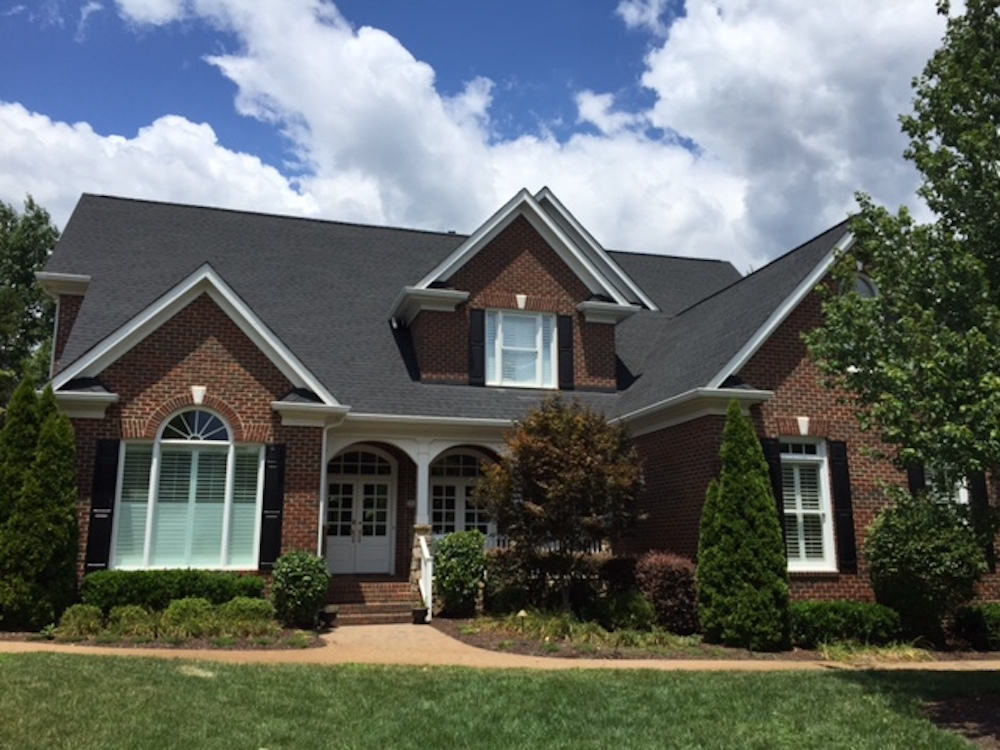 Roof replaced with Onyx Black architectural shingles by Owens Corning. Located in Ballantyne.